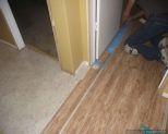 Dream Home, Kensington Manor 12mm laminate flooring Texture close up installing under a door jamb
