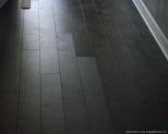 Lamton Virginia walnut laminate flooring, showing defect on the finish closer look