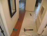 Harmonics laminate flooring installation, I installed a couple of rows into the hallway from the living room