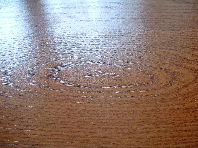Quick step Eligna laminate flooring single board design showing woodgrain texture.