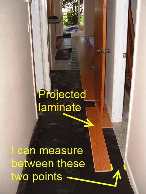 Installing laminate down hallways from another room for How to lay laminate flooring through a doorway