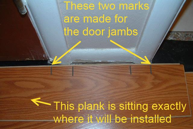 Hallways, installing the last row of laminate flooring in hallway under door jamb requires that you mark where the door jambs are so you can take measurements.
