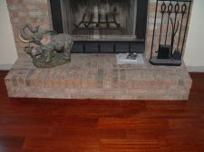 Here in this photo is the finished fireplace after undercutting and installing laminate or hardwood flooring under it.