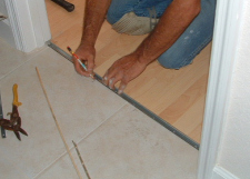 I'm marking the holes on the laminate transition track so I know where to drill