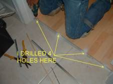Here I drill 4 holes for the laminate transition track