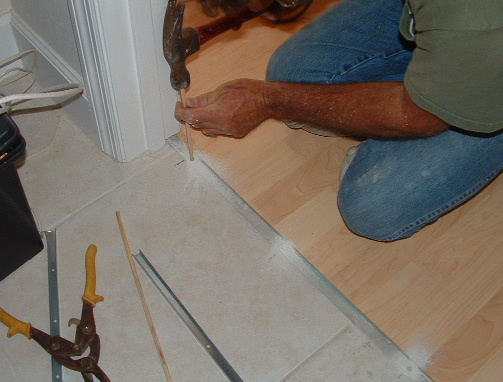 Insert Dowel In The Hole So The Track That Holds The Laminate Molding Can Be Installed