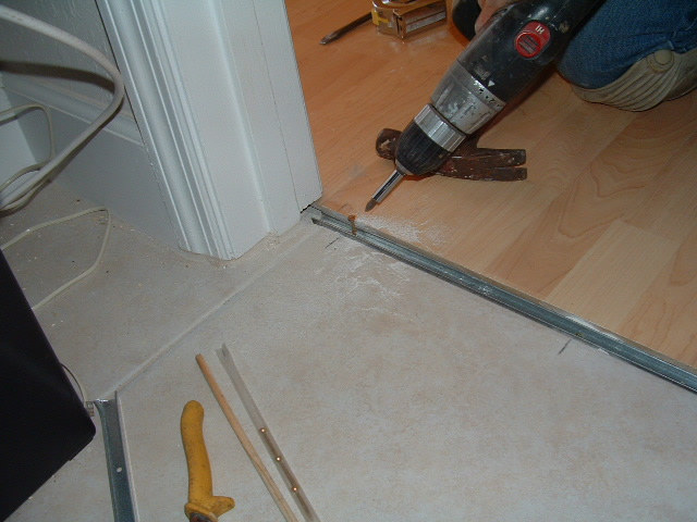 Marvelous Laminate Flooring Door Transition Part - 8: Screw The Track Down For The Laminate Transition