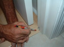 Here I'm notching the laminate trim to fit to the door jamb