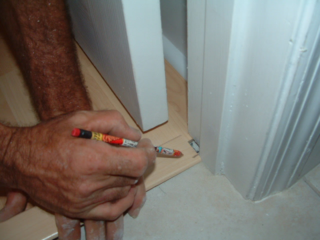Here I M Notching The Laminate Trim To Fit To The Door Jamb