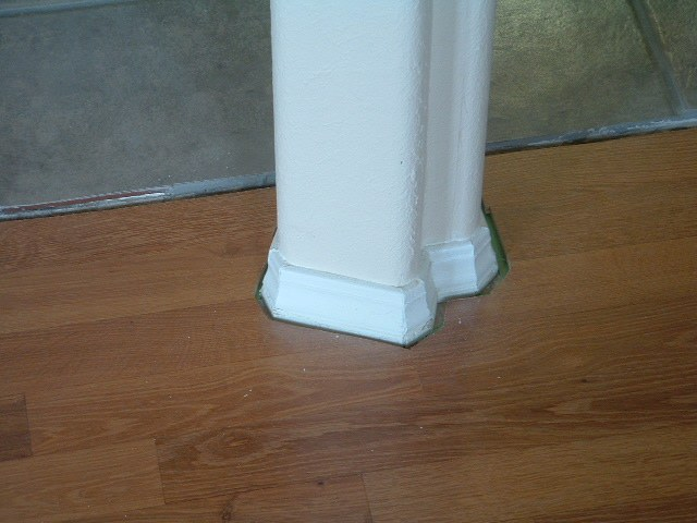 Installing quarter round on round corners, around an odd shaped pillar, Before photo..