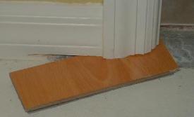 Cut door jamb with laminate sample.