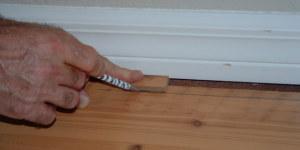 Scribing Swiftlock laminate flooring from Lowes along baseboard