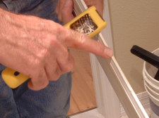 Use a rasp to remove the old chalking from the base board so it can be painted and reinstalled.