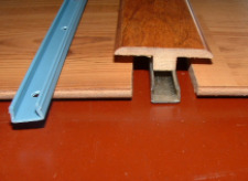 Here is a T-mold with the track. This shows how they will fit together