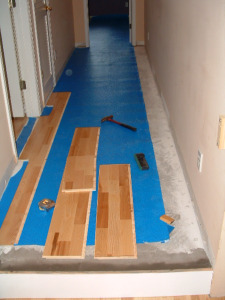 Starting the installation of the Kahrs floating wood flooring.
