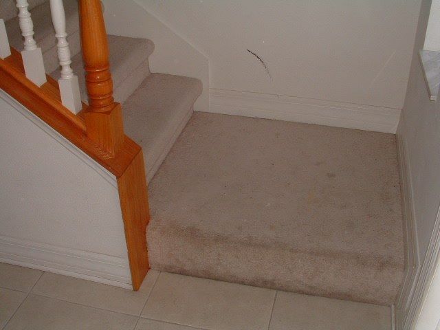 Before Lowes Mohawk laminate flooring installed on stairs