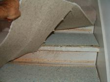 Removing the carpet so laminate flooring can be installed on these stairs