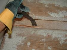 Removing tack strip with pry bar from stairs