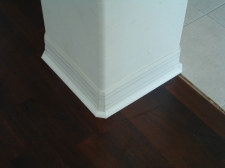 I installed 1/4 round on the existing base board with the cut corners after installing Mohawk laminate from Lowes.