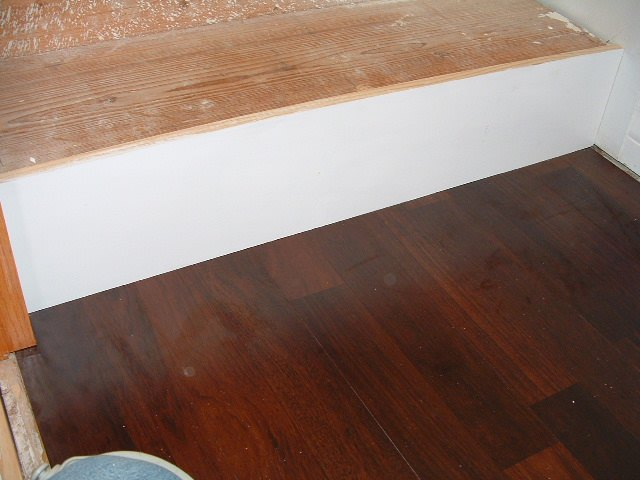 Scribing The Bottom Of The Riser For Installing Laminate Flooring On Stairs.  Here Is The