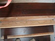 Laminate flooring on stairs. I applied the glue to the back of the riser before installing it.