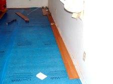 Here I'm starting the first row of Vanier laminate flooring