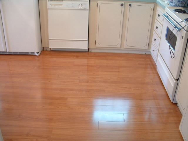 Laminate flooring in kitchens do it yourself installation for Kitchen laminate flooring