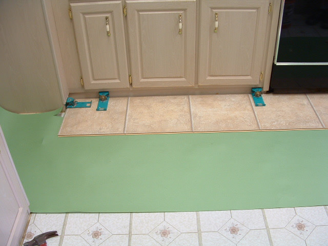 Installing The First Row Of Laminate Tile Laminate Flooring In A Kitchen