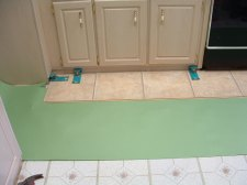 Installing the first row of laminate tile