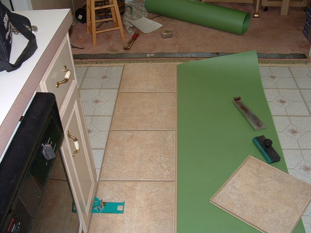 Amazing Installing Laminate Tile Flooring Part - 4: Installing The First Row Of Quick Step Laminate Tile Flooring