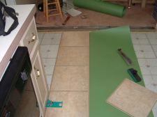 Installing the first row of Quick Step laminate tile flooring