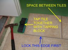 Quick Step tile being tapped together with a tapping block