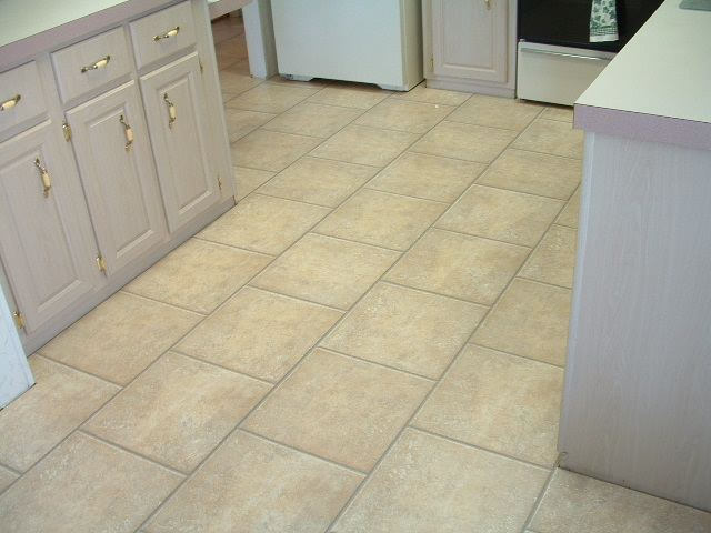 AFTER  The Quick Step Laminate Tile Installed In This Kitchen Is 15 1/2  Inches Square.