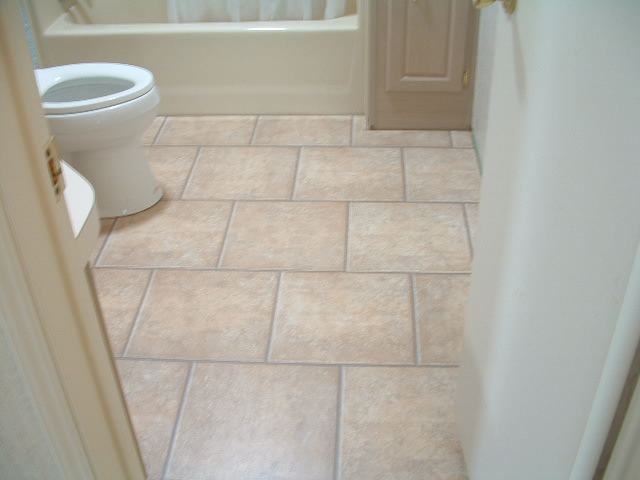 AFTER  The Quick Step Tile In This Bathroom Is 15 1/2 Inches Square. The  Toilet Is Reinstalled.