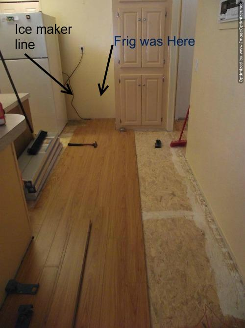 Laminate flooring in kitchen installation