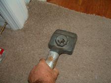 Using a carpet kicker to finish off carpet at laminate transition