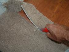 Cutting carpet at laminate transition