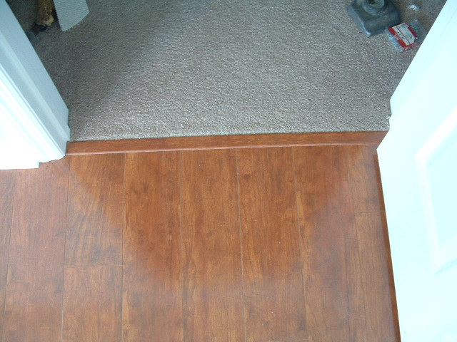 Laminate flooring put transitions laminate flooring for Carpet and laminate flooring