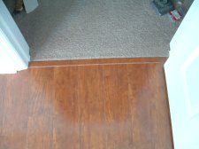 Carpet finished off at laminate transition