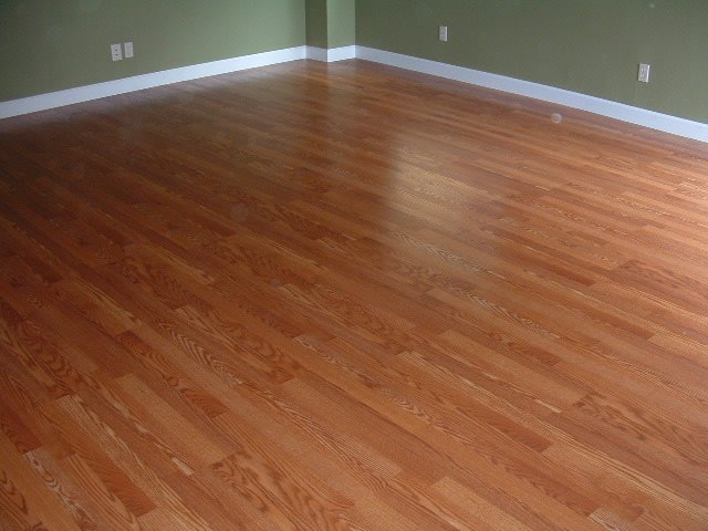 AFTER  I Installed Sams Club Traditional Living Laminate Flooring And The  Base Board In This Room.