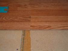 The final step to connect the Pergo Casual Living laminate flooring planks together.