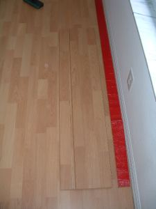 Installing the last row of laminate flooring photo