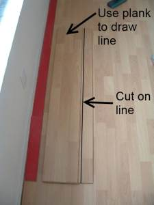 Installing the last row of laminate flooring, next I draw a line where I made marks after measuring the space.