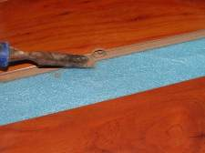 This photo is True floor laminate flooring from Ifloor.com, Color: Tiramisu Surprise, shaving off some of the locking system.