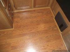 Installing laminate flooring in a travel trailer, installed quarter in the kitchen