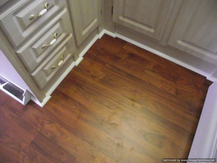 Allen & Roth laminate flooring being installed.in a small kitchen ...