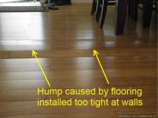 Hump on laminate flooring from being too tight against walls