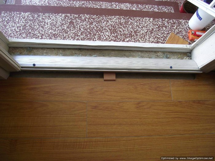 Installing transition for laminate at entry door