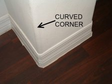 Installing quarter round on round corners,this shows the curved corner on the wall.