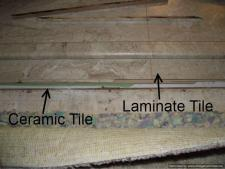 Laminate tile flooring in bathroom over ceramic tile.